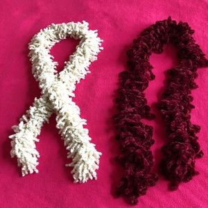 Fuzzy set of two maroon and white scarves